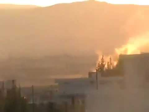 Homs, Syria: Regime tanks shell the town of AlHoulah