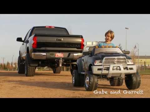 2014 Toyota Tundra vs Kid Trax Dodge Ram - Tug Of War!