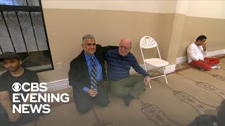2 men try to explain the meaning of Islam to the country