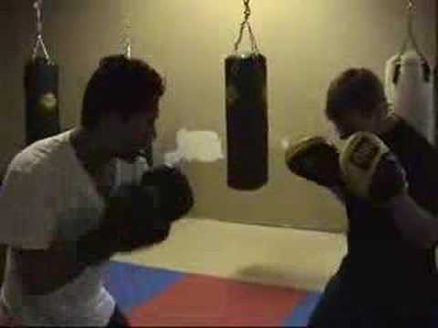 Pad work boxing training for MMA Image 1