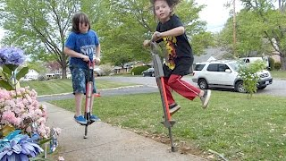 Rowan and Ivan jump on pogo sticks!