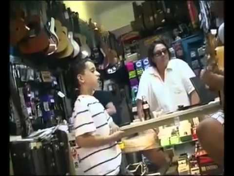 Guitar Store Owner Shocked By Little Boy's Incredible Voice