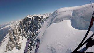 Skier Paraglides Off Cliff Edge
