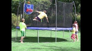 Skywalker Trampolines Jump N Dunk Trampoline with Safety Enclosure and Basketball Hoop Blue 15 Feet