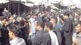 MATLI MAZAMATI RALLY PART 1 (BOMB BLAST ON YOM-E-AASHURA JALOOS IN KARACHI) 1431.flv