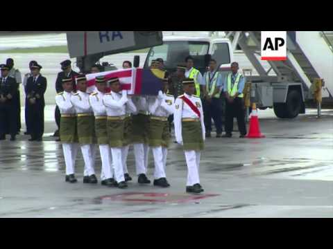Nine more bodies from flight MH17 are flown back to Kuala Lumpur
