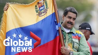 Venezuela crisis: Thousands of Nicolás Maduro supporters march through Caracas