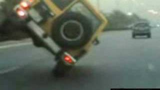 Nissan Patrol riding on 2 wheels - nice trick