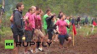 Russia: Championship swamp footballers play knee deep in mud