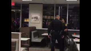 Police. Brutality. To a girl in burger place