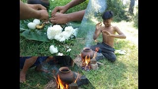 Primitive Technology - Two boys are eating eggs with rice