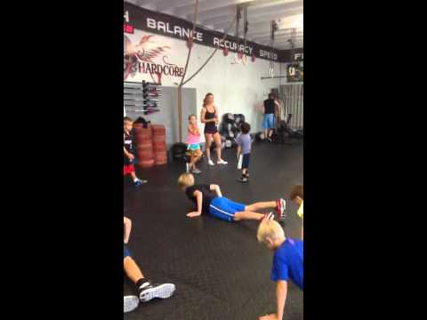 Cayden and Shelby Coaching Crossfit Kids (helping)