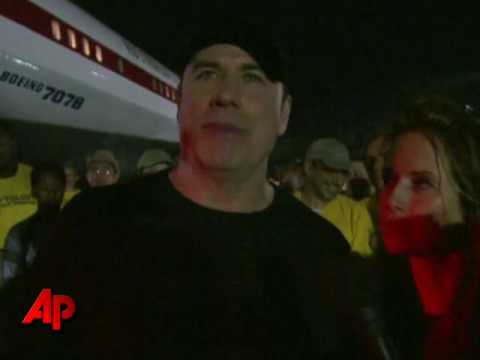 Raw Video: John Travolta Flies Relief Into Haiti