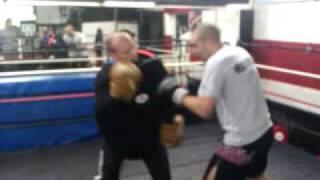 Ben McDonald trains Alex 'one man riot' Matvienko on the pads