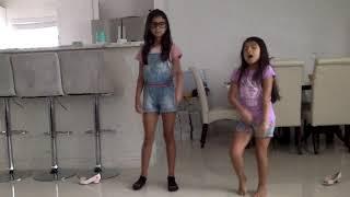 dancing Taki taki with sis