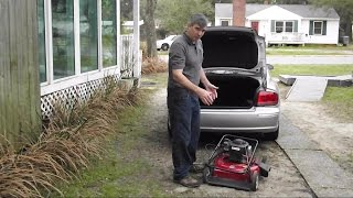 How to fit mower into car trunk