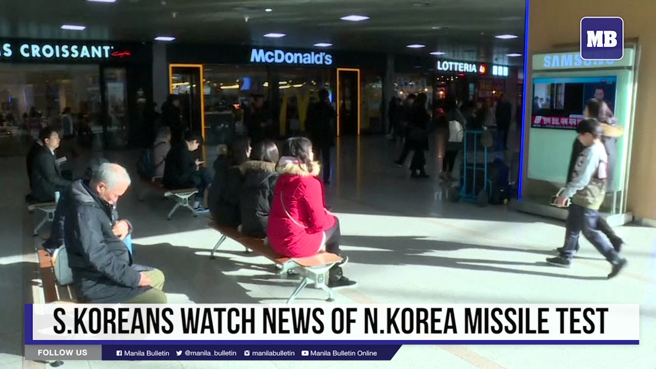 S. Koreans watch news of N. Korea missile test