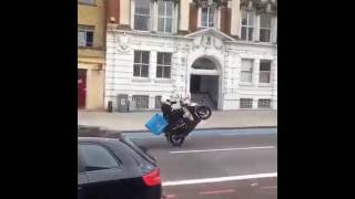 Pizza delivery man Fails to pull off the ultimate wheelie in Clapham