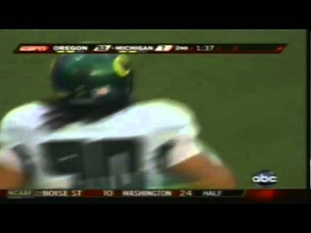 Oregon DT David Faeteetee drops Michigan RB Mike Hart for a loss 9-08-07