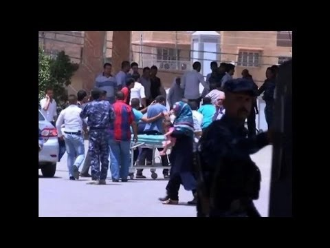 Suicide bomb at police checkpoint kills at least 21 in Iraq