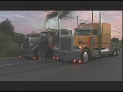 big trucks drag race in traffic Video