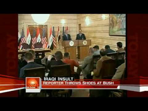 msnbc.com video  Bush dodges flying shoes in Baghdad.flv