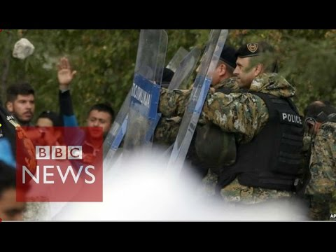 Macedonia police fire tear gas at migrants - BBC News