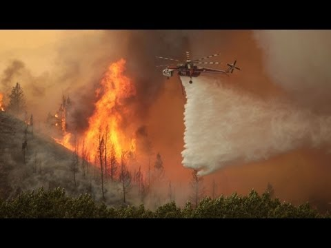 A Wildfire destroys more thank 10 homes and forces evacuations in Idaho and Utah