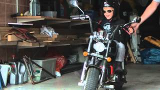 2 year old girl rides her own Harley to daycare