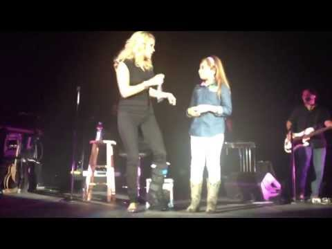 Little Girl sings with Carrie Underwood and takes over the stage.  Genesis Keren Nava
