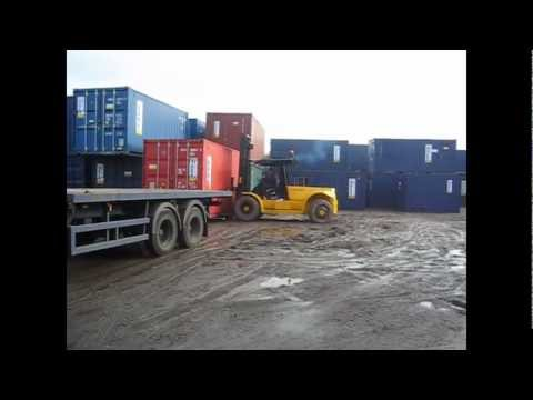 Container Hire - UK  Bell container hire london forklift unload used container from hire fleet