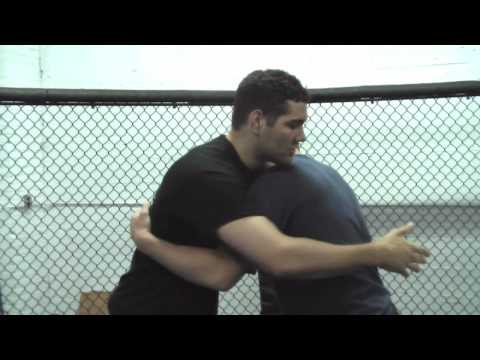 Overhead belly to belly suplex with Chris Weidman Image 1