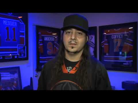 Daron Malakian shows his living room/Oilers shrine