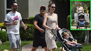 Behati Prinsloo & Adam Levine looked happy to be taking their eldest child Dusty for a stroll in LA