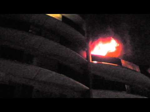 Firefighters perform balcony rescue at high-rise fire