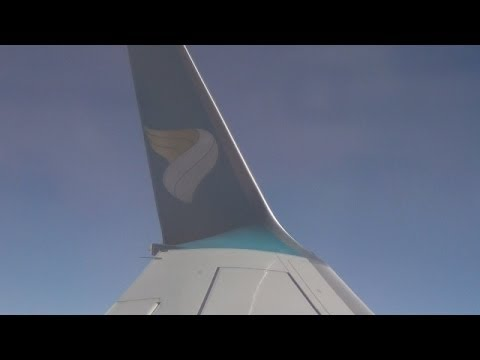 Landing at Runway 25 Salalah International Airport with a view over the new under-construction Salalah Airport onboard: Oman Air Boeing 737-800 A4O-BG Flight: WY 905 18 November 2013 from:...