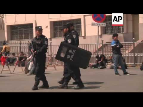 China - Security and clean-up at train station after attack / Attackers drive through shoppers while