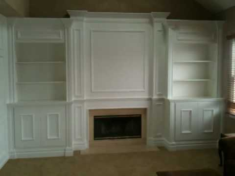 Fireplace mantel with surrounding built-ins, all created by CarpentryMasters.co - YouTube