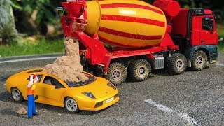 RC CONSTRUCTION TOYS FAIL - Lamborghini covered with concrete! Bruder truck action for kids!