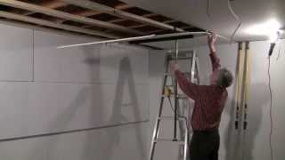 One man drywall installation on ceiling