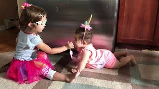 Happy birthday to you! Trying to sing to her baby sister!