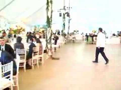 Short Pan of the reception tent,wedding cake, and the live band