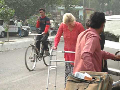 Amanda Walking with Leg Braces in the Streets of Delhi - One Brave Woman!