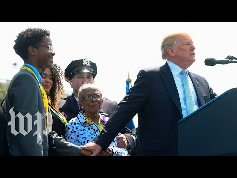 Trump clutches grieving family of fallen officer