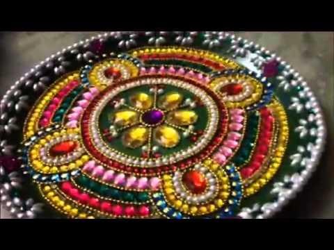 Download peacock kundan rangoli by maruthi devi youtube for Aarti thali decoration with kundan