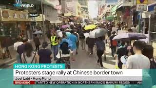 Hong Kong protesters stage rally at Chinese border town