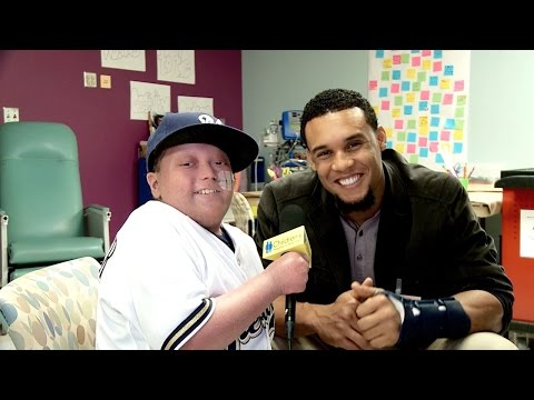 Cancer patient interviews Carlos Gomez from Milwaukee Brewers during Children's Hospital visit