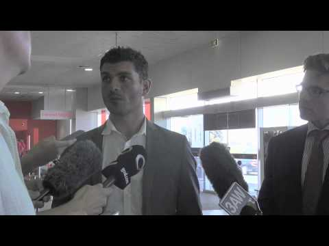 Head Coach John Aloisi speaks to the media