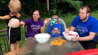 Aydens Playtime does the Flaming Hot Cheetos Challenge! Very hot!