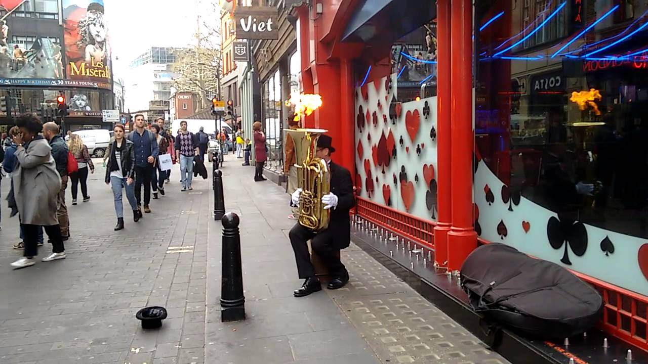 Buskers In London Want Your Money So Much That They're Now Playing With Fire